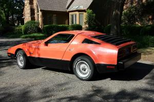 1975 Bricklin, red, daily driver.  Custom interior