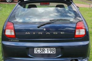 Mitsubishi Mirage 2003 3D Hatchback 5 SP Manual 1 5L Multi Point F INJ in Quakers Hill, NSW