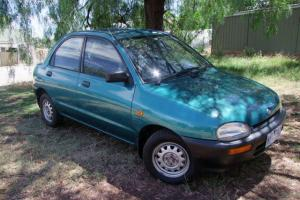 Mazda 121 1995 4D Sedan 5 SP Manual 1 3L Single Point F INJ in Bendigo, VIC