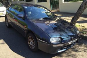 Mazda 323 Astina 1997 5D Hatchback 5 SP Manual 2L Multi Point F INJ in Stanmore, NSW