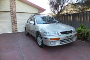Mazda 323 Protege 1995 4D Sedan 4 SP Automatic NOT Ford Laser in Tahmoor, NSW