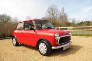 1995 Rover Mini Sprite in Flame Red and just 25,00 miles