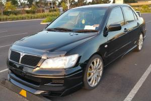 Mitsubishi Lancer ES 2003 4D Sedan Manual 2L Multi Point F INJ 5 Seats GSR