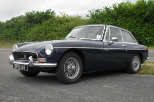 1970/H MG/ B GT Dark Blue with chrome Bumpers. Black trim inside.