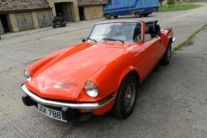 Triumph Spitfire 1500 in vermillion red (orange)