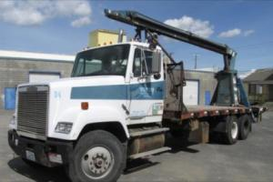 freightliner semi with flatbed and jiffy jib boom crane Photo