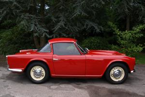 1962 TRIUMPH TR4 RED CONVERTIBLE WITH SURREY TOP. GREAT CONDITION ONLY 35K MILES