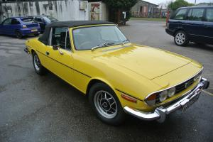 Triumph Stag, original V8 engineAuto in yellow  Photo