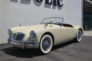 1957 MG 57. Off white. Red Interior. 4 Speed Manual. Convertible.