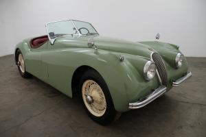 1954 Jaguar XK 120 Roadster, matching numbers, willow green w/ red interior