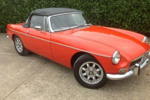 MG B Roadster...blaze orange..superb bodywork with leather interior. Overdrive.