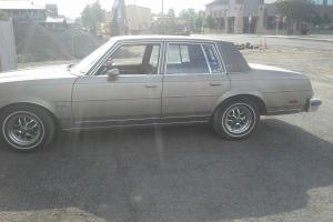 Oldsmobile Cutlass Brougham 84, 4 door, nice rally wheels, vinyl top, classic Photo
