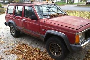 for sale red 1988 jeep cherokee larado 4.0l straight 6 4X4 4dr