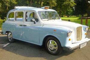 London Convertible Taxi. Weddings etc. Photo