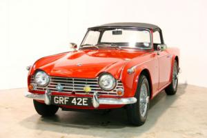 1967 Triumph TR4A - Signal Red With Black Interior - Surrey Top - Overdrive Photo
