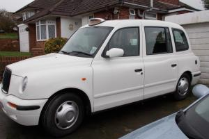 London taxi silverTX11 2002 auto in original white