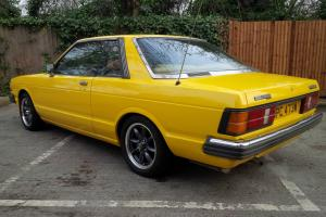 1981 DATSUN BLUEBIRD CPE YELLOW
