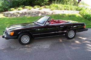 Classic car in great condition, black exterior/red interior, convertible, 2 tops