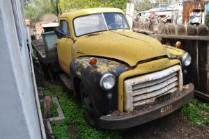 1953 GMC 2-ton flatbed truck with original plates. Yellow with clear title