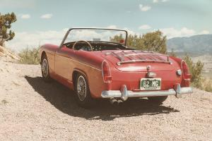 Restored '62 MG Midget, Red with removable top and side curtains, good shape! Photo