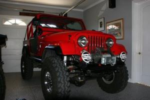 Show winning custom CJ-7 Jeep and 1992 M101 Canadian 1/4 Ton Trailer