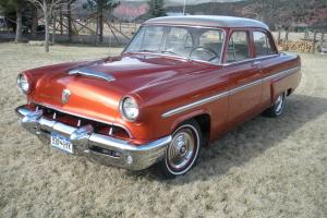 1953 Mercury, four door, 95% restored, engine & trans rebuilt, all new tires.
