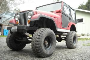 "1970 Jeep CJ5 , Kaiser, 35"" tires, twin stick transfer case, and full soft top"