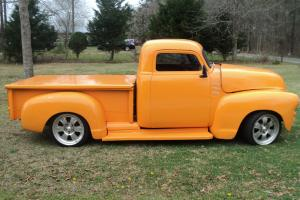 This is an orange 1955 Chevy, that needs a few more minor details put into it.