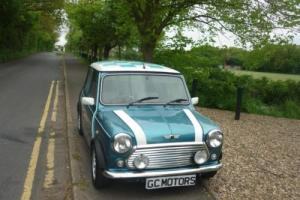 Rover Mini Cooper in Hawaiian Blue with Chequered Roof Decals Photo