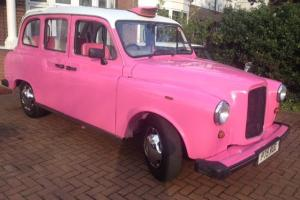 London Wedding Taxi. Roll Top Convertible. PINK, Fairway. Nissan Engine. Auto.