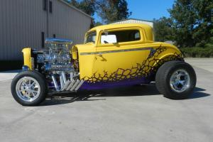 1932 yellow ford  3 window coupe