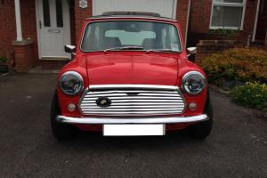 1990 Classic Rover Mini Mayfair, 998cc. Red with a black roof.