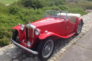 1949 MG TC Red/tan. 4-speed. Wire Wheels. RHD. Excellent driver. Older resto.