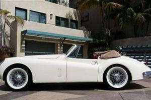 1956 JAGUAR XK 140 DROPHEAD JUST COMPLETED FRAME OFF RESTORATION EXTRAORDINARY