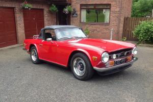 TRIUMPH TR6 RED soft top sports car Photo
