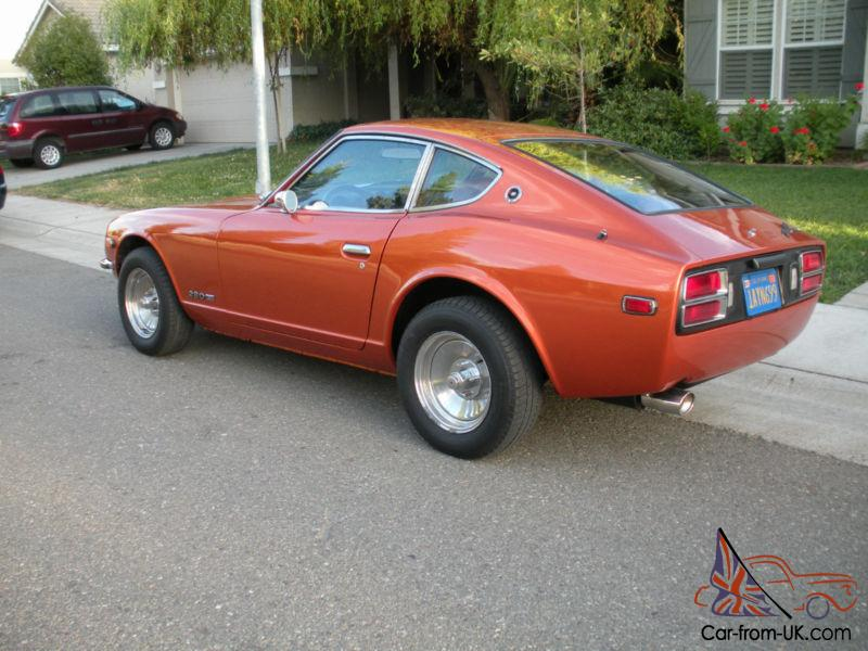 This classic. collectible 1976 DATSUN 280Z completely restored 2 seats  coupe. featured in orange metallic exterior (including engine compartment).  over a ...
