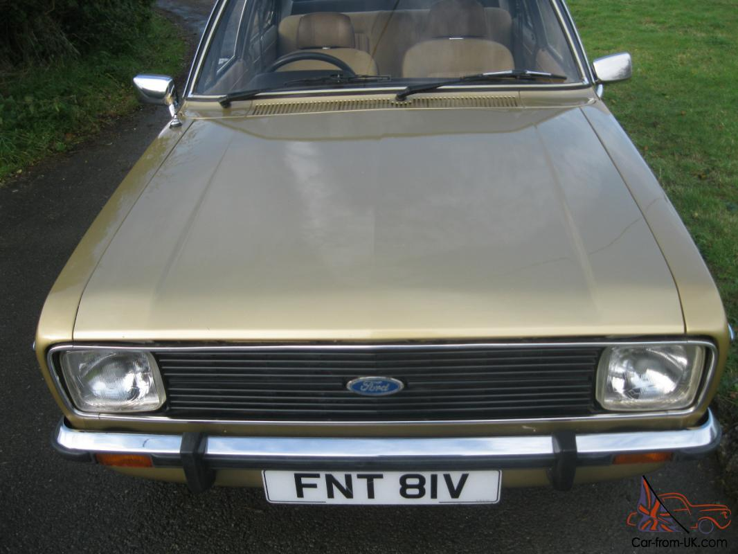 Gold ford escort