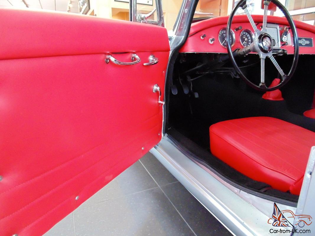 1957 mga coupe with new paint new leather interior and carpet. Black Bedroom Furniture Sets. Home Design Ideas
