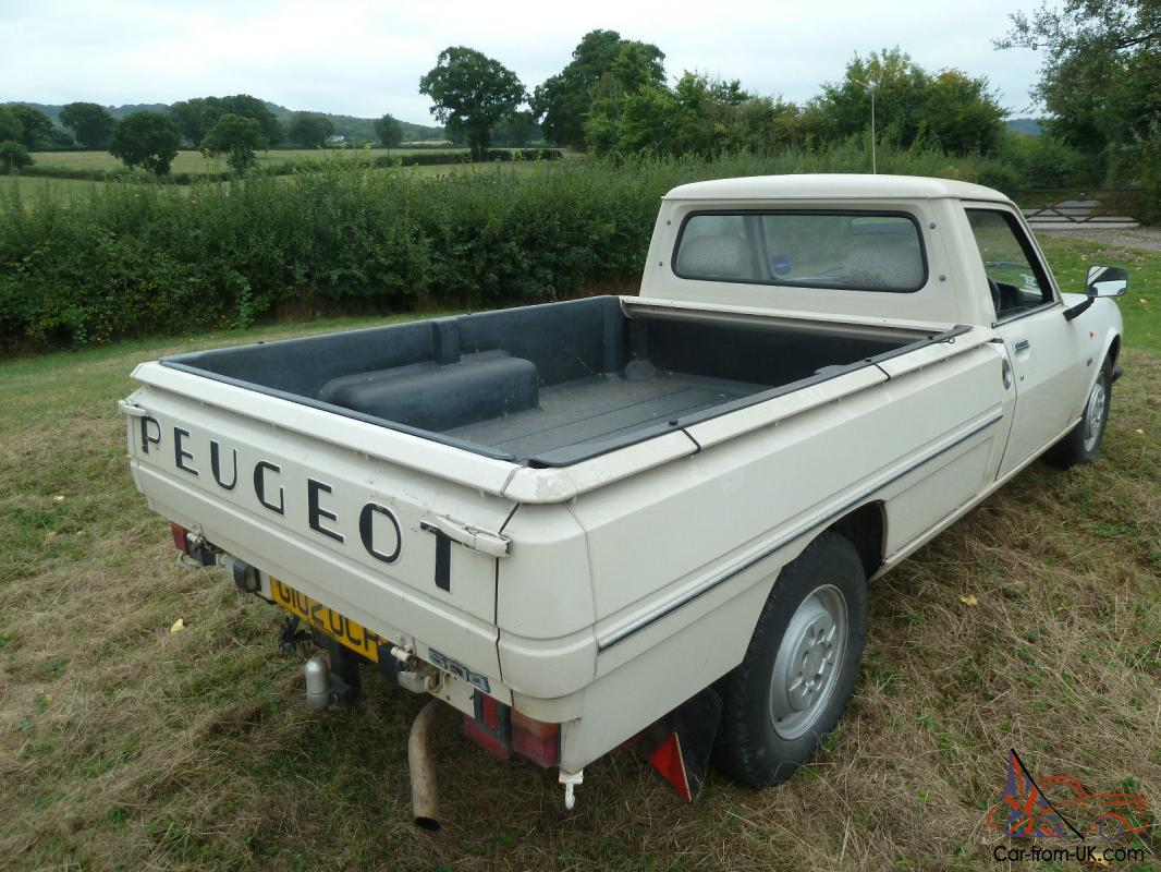 peugeot 504 pick up with demountable classic camper. Black Bedroom Furniture Sets. Home Design Ideas