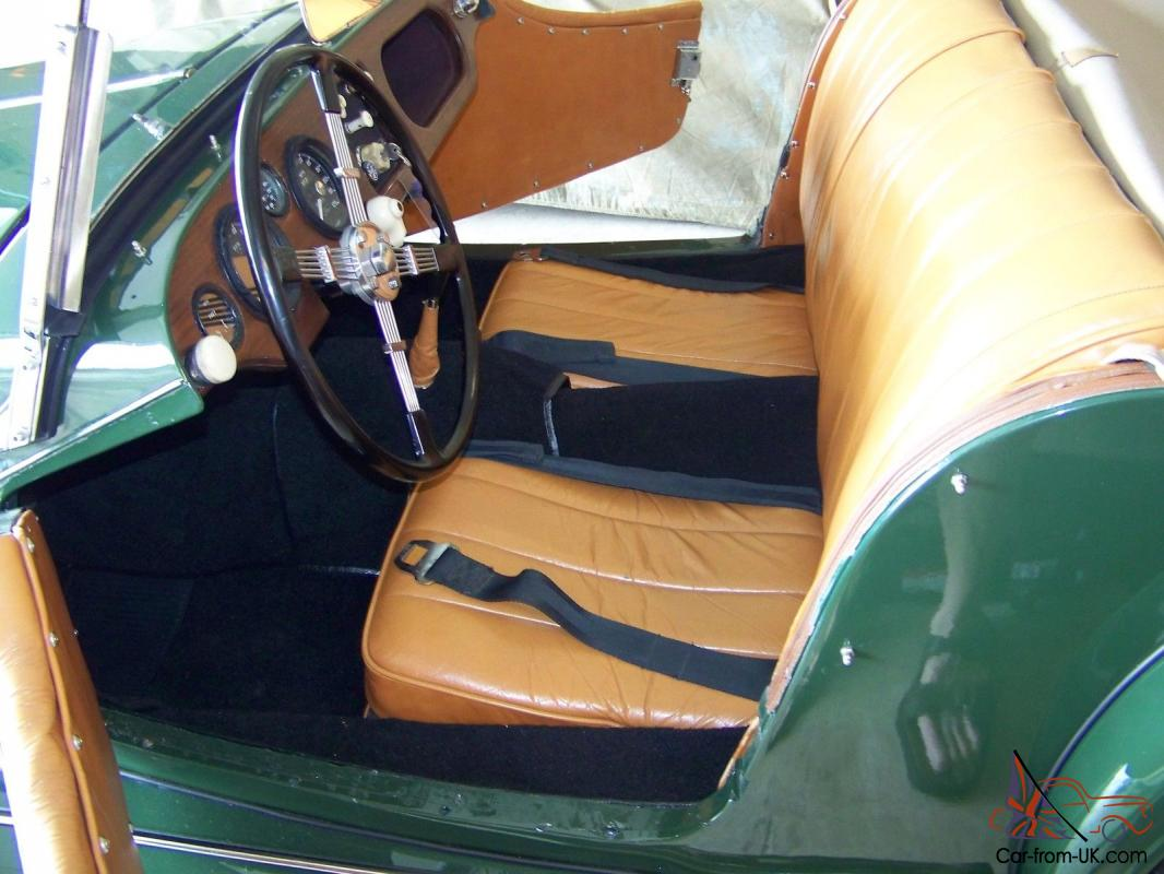 british racing green tan leather interior with custom black pile carpet. Black Bedroom Furniture Sets. Home Design Ideas