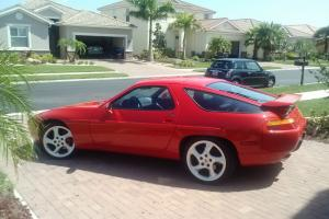 Beautiful  new Red  paint w/ black leather interior, upgraded wheels & more