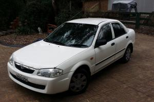 Mazda 323 Protege Shades 1998 4D Sedan 5 SP Manual 1 8L Multi Point F INJ in Silverdale, NSW Photo