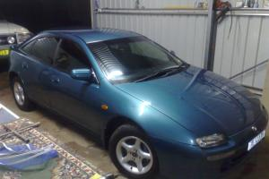 Mazda 323 Astina 1997 5D Hatchback 5 SP Manual 2L Multi Point F INJ in Millthorpe, NSW