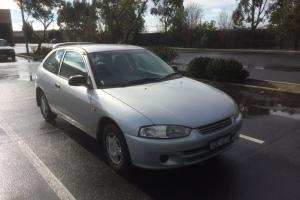 Mitsubishi Mirage 2003 3D Hatchback 5 SP Manual 1 5L Multi Point F INJ in Hamlyn Heights, VIC Photo