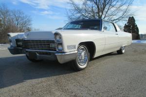 Cadillac : DeVille white