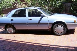 Mitsubishi Magna TP GLX 1990 4D Sedan 4 SP Automatic 2 6L Carb in Dandenong North, VIC Photo
