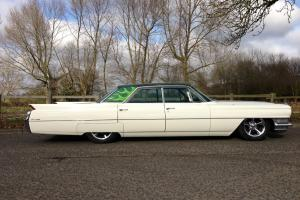 Custom 1964 Cadillac sedan. Bagged, chrome 5 spokes. Recent California import