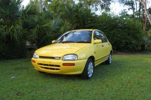 Mazda 121 1992 4D Sedan 5 SP Manual 1 3L Single Point F INJ in Nerang, QLD