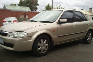 Mazda 323 Protege 1999 4D Sedan Manual 1 8L Multi Point F INJ Seats