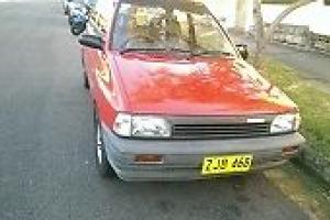 Mazda 121 FUN TOP 1988 3D Hatchback Manual 1 3L Carb Seats in NSW